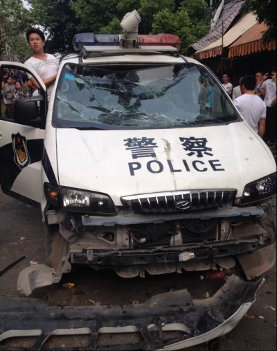 CHINA: Police Brutally Beat a Woman On The Streets, Men Begin Killing Cops on the Streets.