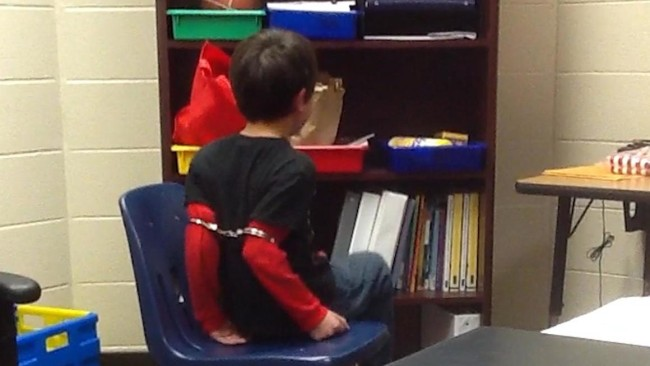 A Deputy Sheriff Handcuffed Young 8- Year Old Boy With ...  A Deputy Sherif...