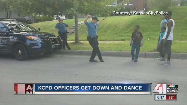 KCPD_officer_dances_with_neighborhood_ki_1896570000_7332890_ver1.0_640_480
