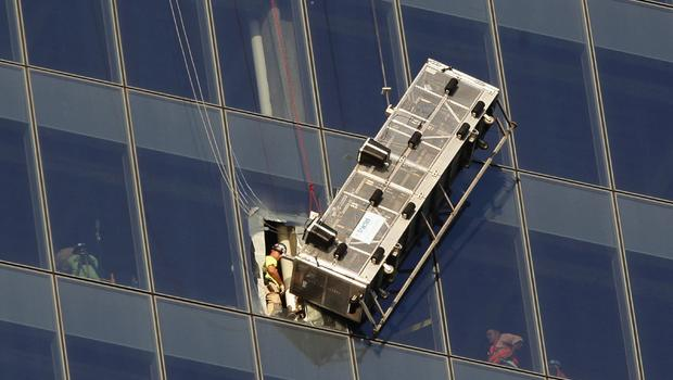 FDNY CUTS THROUGH 1 WORLD TRADE WINDOW TO RESCUE WORKERS TRAPPED ON SCAFFOLD