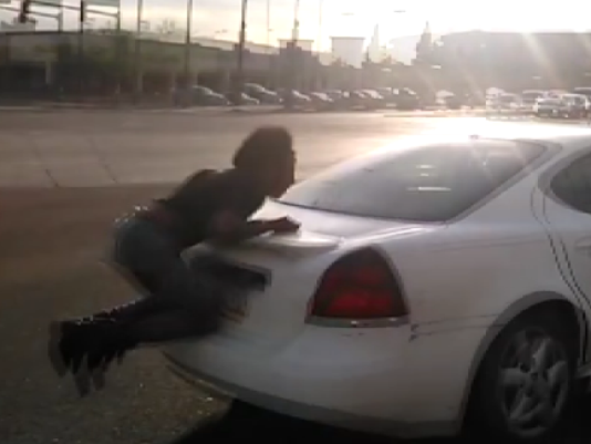 Hit & Run Caught on Video While Victim Continues Hanging On Car