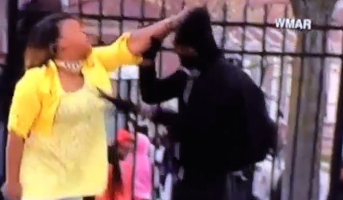 [VIDEO] A Mother Allegedly Pulls Her Kid Off The Streets In Baltimore Not Before Giving Him A Major Beatdown
