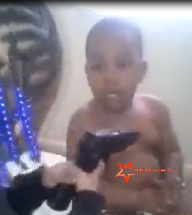 Young Girl Plays With Real Gun Inserting Clip In Gun & Pointing At Little Boy While Adult Laughs