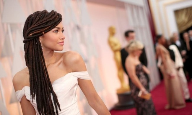 """And more recently, in 2007, good ole Jamaica sent its first Rastafarian contestant to the rivaling Miss Universe contest, Zahra Redwood— her lioness locks tickling her buttocks. She didn't place. And while our current Miss Jamaica World is a vegetarian who loves listening and dancing to reggae, Dr. Myrie publicly only admits to a coffee habit—which she sips through a straw to keep her teeth white—and doesn't rep Rastafarianism as her reason for locking her hair, but Jamaica itself. """"I lock my hair because I identify with it. I am very much rooted in that Afro-centric nature, where we as Jamaicans are rooted. It's my expression,"""" she states. Once sacred yet frowned upon by previous generations for its associations with poor hygiene, weed smoking, and criminality, dreads have grown more visible in popular culture, thanks to talents like Whoopi, Stevie, Lauryn, and Lisa Bonet. While American celebs have somewhat divorced the 'do from Rastafarianism, transforming the style from an indicator of spirituality to mere fashion, self-expression, and quixotic free-spiritedness, the truth about how welcomed the hairstyle is to other realms of life remains questionable."""