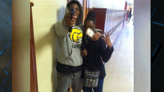 Disturbing Photo Of A Man Pointing A Gun In A High school & He Is Not A Student