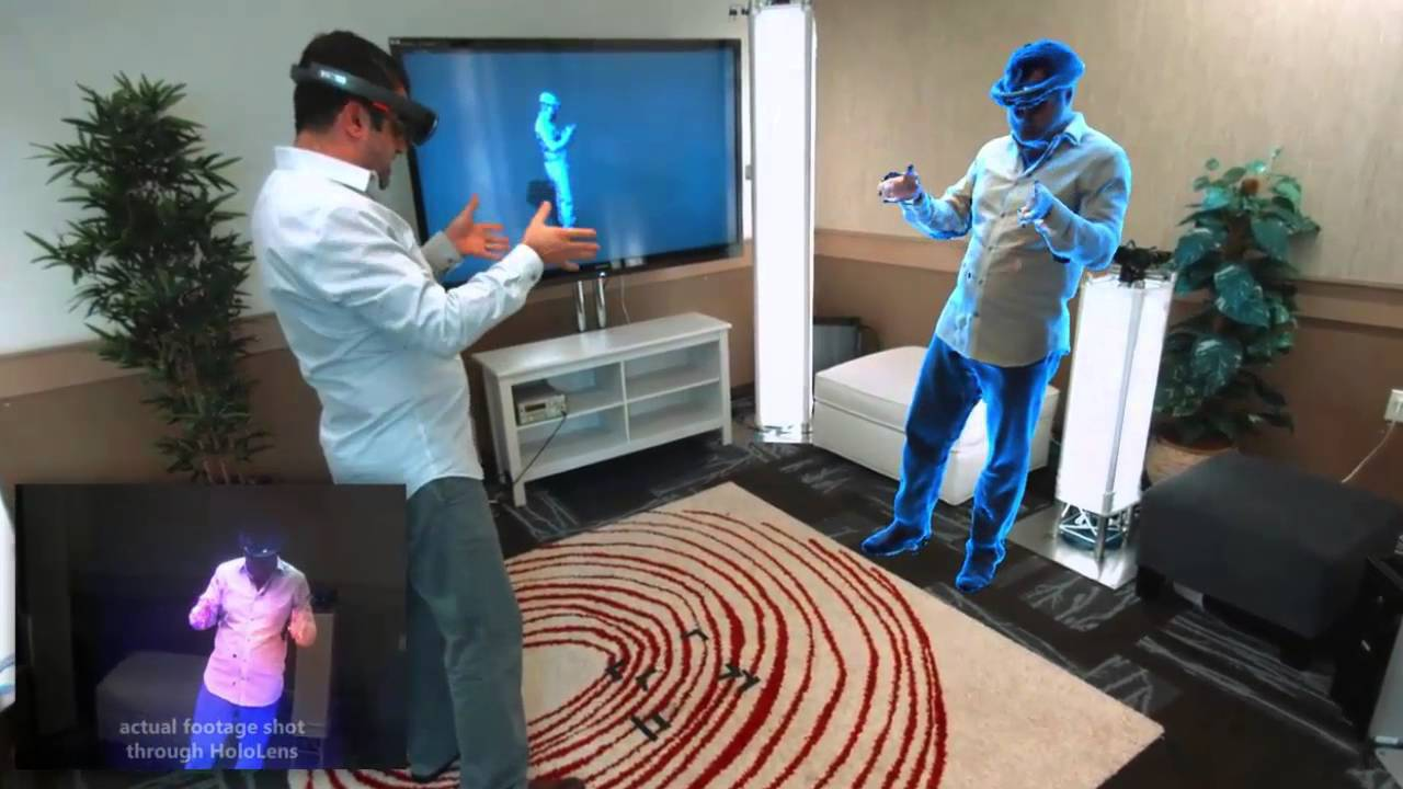 A Microsoft employee is seen viewing a 3D version of himself in real-time thanks to holoportation. The box on the bottom left shows what he sees, while the child's actual physical location is seen in the top left box. Photo Credit: YouTube