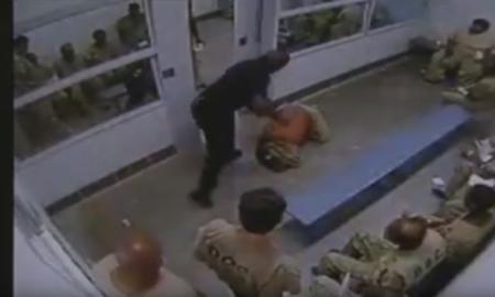 guard beats up inmate