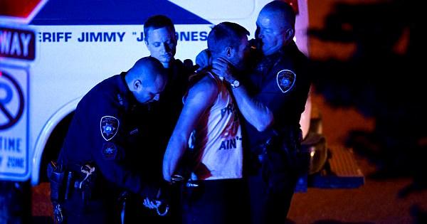 Cop choking white student