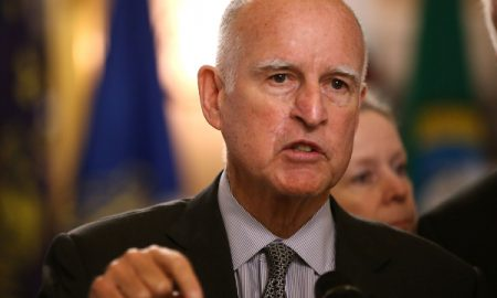 Governor Jerry Brown Of California Signs A Bill Allowing Felons In Jail The Right To Vote