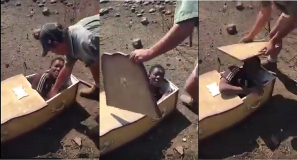 Video Surfaces Where White Men Forcefully Puts A Black Man In Coffin With Plans Of Burrying Him Alive In South Africa
